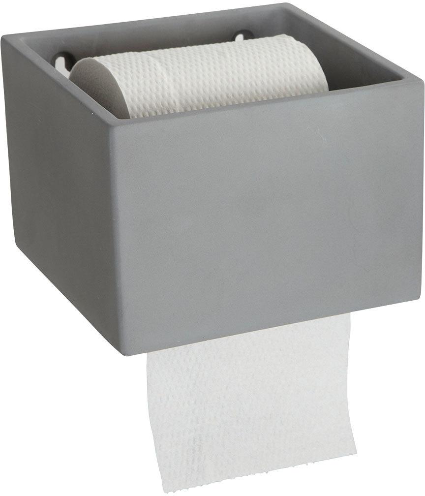 På billedet ser du variationen Cement, Toiletpapirholder fra brandet House Doctor i en størrelse 14,7 x 15 cm. x H: 10 cm. i farven Grå